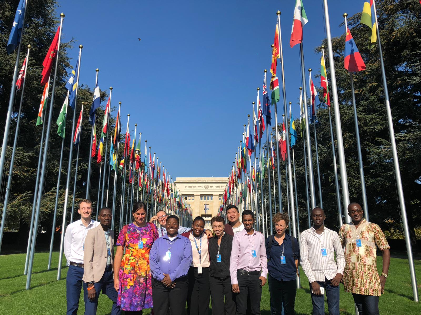 Human rights defenders by the Alley of Flags at the Palais des Nations in Geneva
