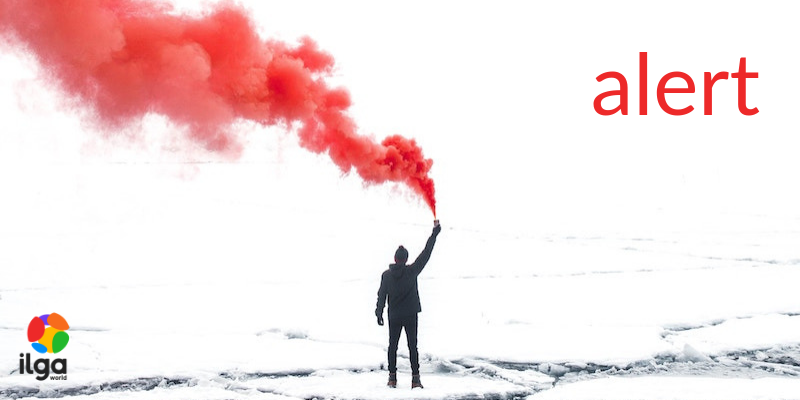 Picture of a figure holding a red flare
